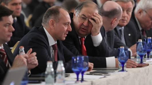 Russian billionaire Alisher Usmanov (centre) among other businessmen