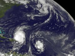 A satellite image tracking hurricane activity over the Atlantic Ocean.