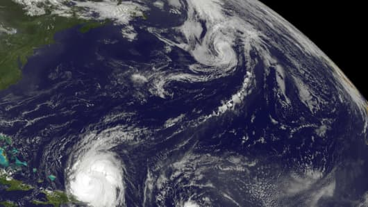 A satellite image of Hurricane Earl (left) and Tropical Storm Fiona in the Atlantic Ocean on Aug. 31, 2010.