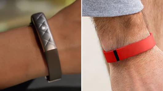 UP by Jawbone (L) and Fitbit (R).