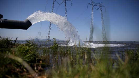 Water is pumped into a field that will be planted with rice on May 8, 2015, in Biggs, Calif.