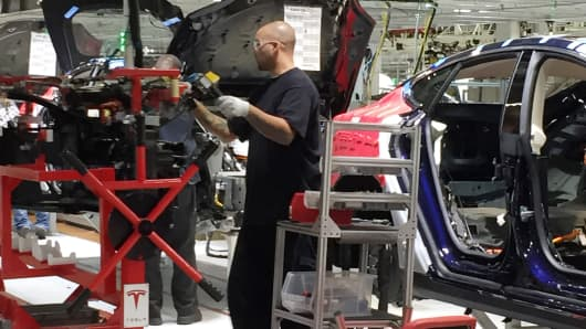 A worker at the Tesla Motors factory in Fremont, CA.
