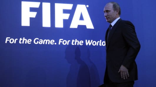 Russian Prime Minister Vladimir Putin arrives to attend a press conference in Zurich on December 2, 2010 after Russia was chosen to host the 2018 World Cup.