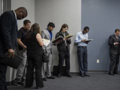 Job seekers wait in line to enter the Choice Career Fair in San Antonio, Texas,