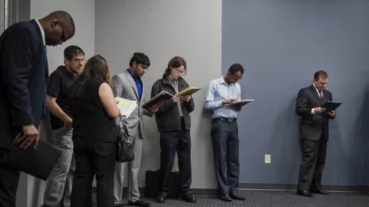 Job seekers wait in line to enter the Choice Career Fair in San Antonio, Texas.