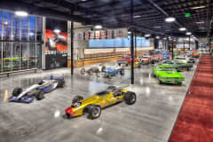 Race cars displayed at the World of Speed Museum.