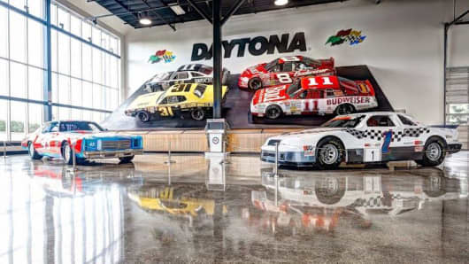 Race cars on display at the World of Speed Museum.