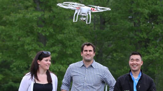 DartDrones co-founder Abby Speicher (left) trains people to operate drones. Here she instructs how to fly a DJI Phantom 2 Vision Plus near Babson College on May 26, 2015.