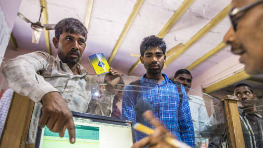 Customers inside a branch of Gramin Bank of Aryavat (GBA) in the village of Khurana, Uttar Pradesh, India.
