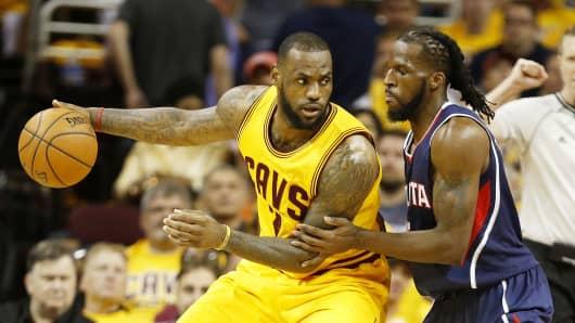 LeBron James drives against DeMarre Carroll of the Atlanta Hawks