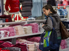 A shopper browses merchandise at an Old Navy store in San Francisco.