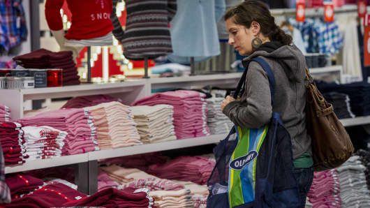 A shopper browses at an Old Navy store in San Francisco.
