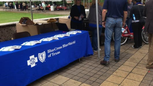 A BlueCross BlueShield of Texas BikeShare table at an event.
