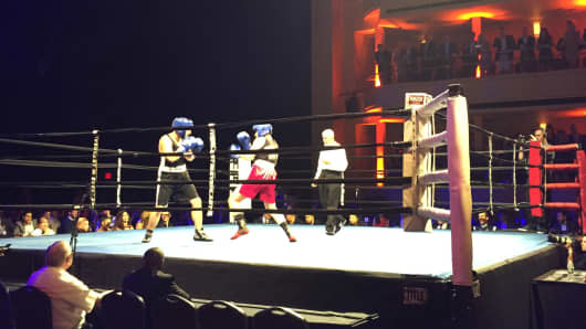 Boxers participate in the Fight For Education, a martial arts event hosted by GLORY to benefit Happy Hearts Fund, at the Hammerstein Ballroom in New York on June 3, 2015.