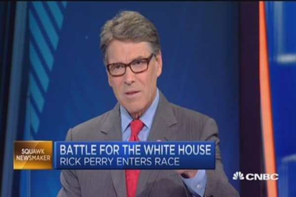 Rick Perry: Lower taxes raises wages