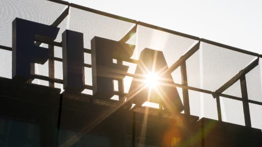 A FIFA logo sits on the rooftop at the FIFA headquarters on June 3, 2015 in Zurich.