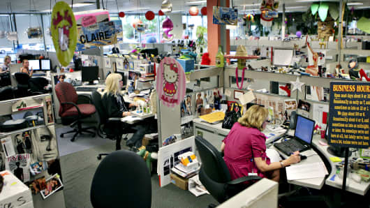 Workers sit at their desks in the couture department at the offices of internet retailer Zappos.com Inc. in Henderson, Nevada.