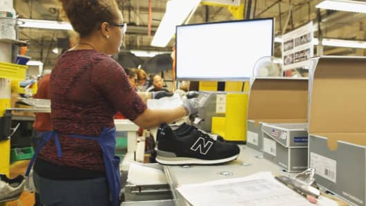 A pair of custom sneakers is packed for shipping in New Balance's Lawrence, Massachusetts, factory.