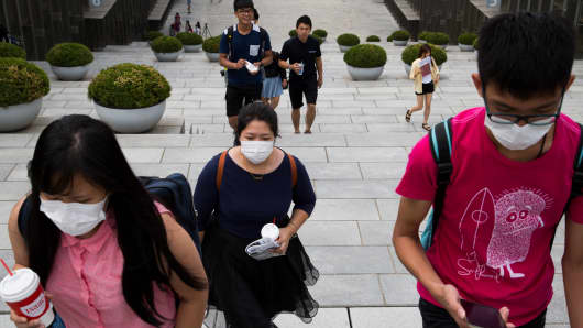 Students wearing face masks in Seoul on Monday, June 8, 2015.