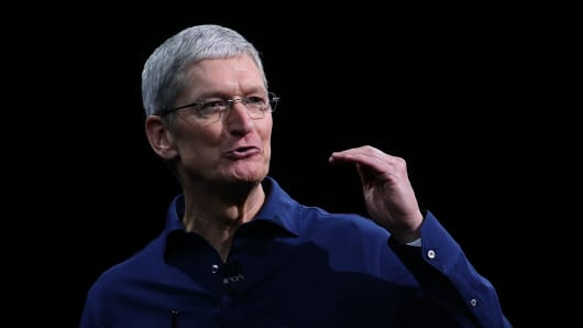 Apple CEO Tim Cook delivers the keynote address during Apple WWDC on June 8, 2015, in San Francisco, California.