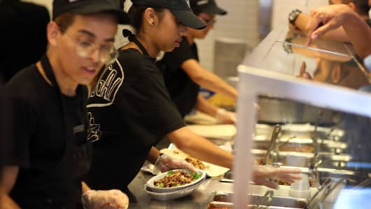 Chipotle restaurant workers fill orders for customers in Miami.