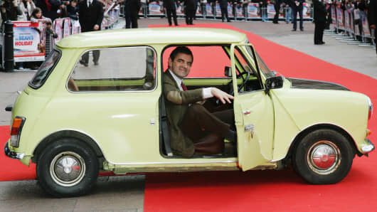 "Rowan Atkinson as ""Mr Bean"" in a 1976 British Leyland Mini 1000 car"
