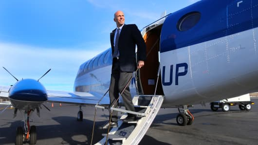 Wheels Up is a new airline travel company co-founded by Bill Allard who stands in front of a new Beechcraft 350i King Air turbojet plane with only 30 hours on it.