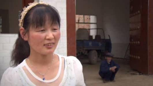 Wang Li, grocer and 'stock market goddess' in Nanliu village.