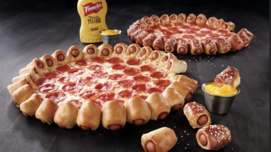 Pizza Hut to unveil hot dog bites pizza.