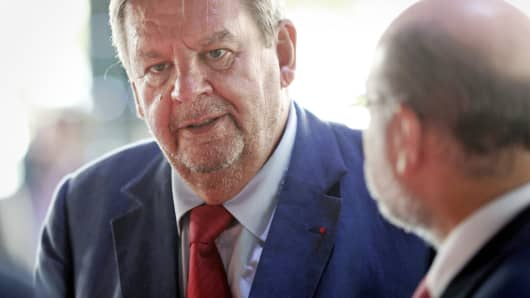 Richemont Chairman Johann Rupert speaks with delegates during the Financial Times Business of Luxury Summit in Monaco, June 8, 2015.