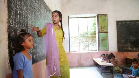 Teacher instructing students in math as part of an Educate Girls school program.