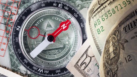 Compass on dollar bills