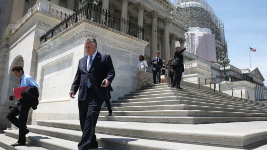 Legislators depart the U.S. Capitol building in Washington.