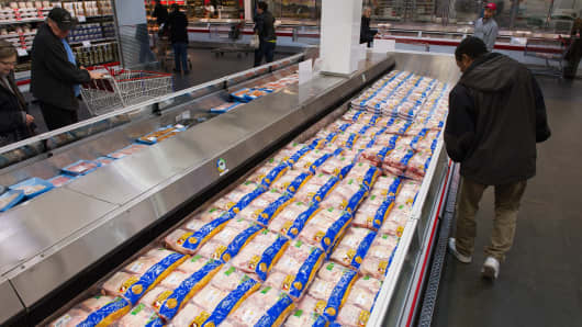 Customers browse chicken displayed for sale at a Costco Wholesale store in San Francisco.
