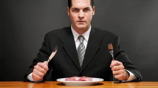 Businessman with raw steak