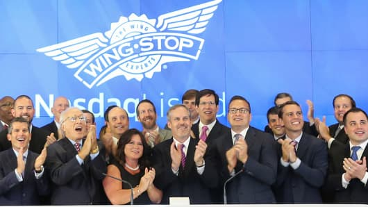 Wingstop makes its trading debut during the restaurant chain's IPO at the Nasdaq in New York on June 12, 2015.