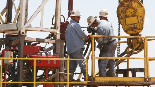 Workers are pictured on a drilling rig near Calumet, Okla.