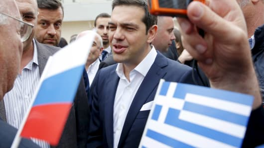 Greek Prime Minister Alexis Tsipras speaks with Greek expatriates during a wreath-laying ceremony in St. Petersburg, Russia, June 19, 2015.