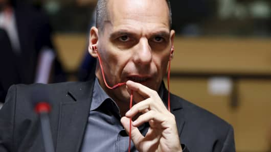 Greek Finance Minister Yanis Varoufakis speaks on his mobile phone during a European Union finance ministers meeting in Luxembourg, June 19, 2015.
