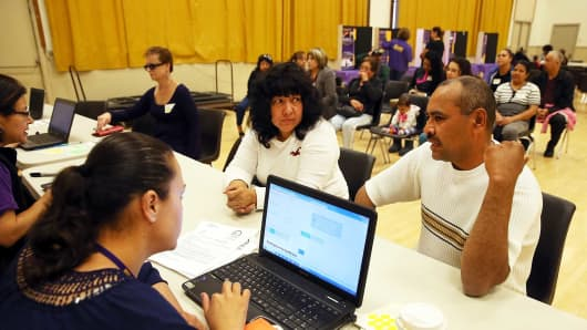 People register for insurance during a health-care enrollment fair at Ambrose Community Center in Bay Point, Calif.
