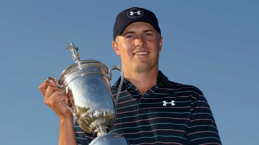 Jordan Spieth poses with the trophy after winning the 115th U.S. Open Championship at Chambers Bay on June 21, 2015 in University Place, Washington.