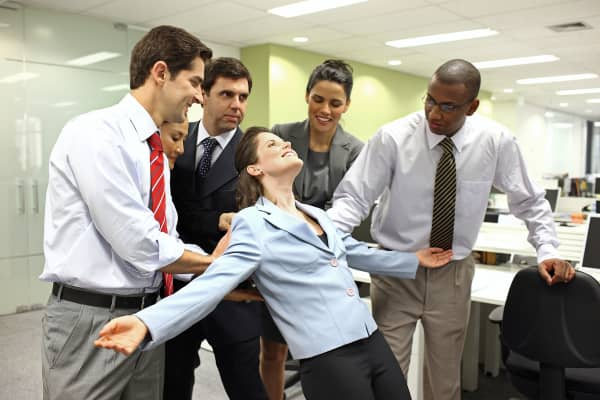 Trust fall exercise in office