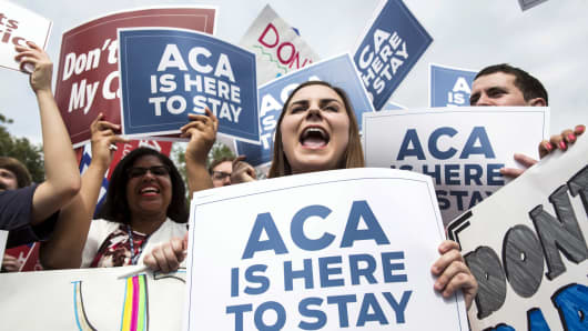 Supporters of the Affordable Care Act celebrate after the Supreme Court up held the law, in Washington June 25, 2015.