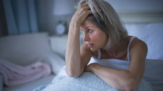 Woman sitting in bed with insomnia