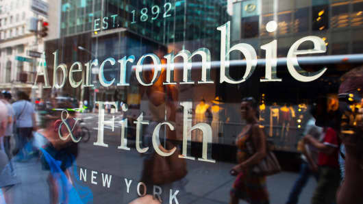 Pedestrians are reflected in the window of an Abercrombie & Fitch store in New York.