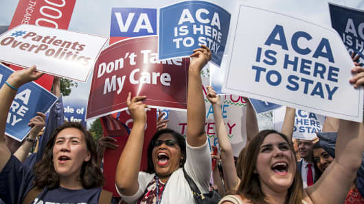 Supporters of the Affordable Care Act celebrate as the opinion for health care is reported outside the Supreme Court in Washington, June 25, 2015.