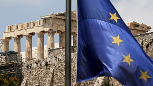 A European Union flag flutters before the temple of Parthenon at the Acropolis hill in Athens, Greece June 26, 2015.