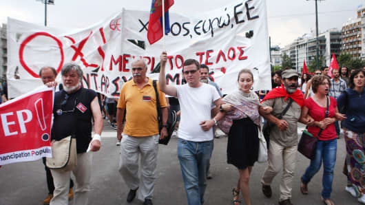 People in front of the Greek Parliament hold a demonstration on June 28, 2015, calling for a 'NO' referendum and for Greece's exit from the euro zone.