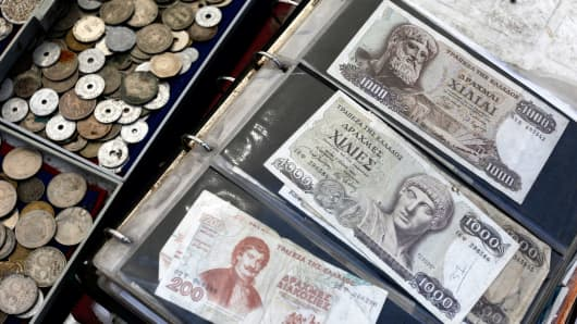 Old Greek drachma coins and banknotes