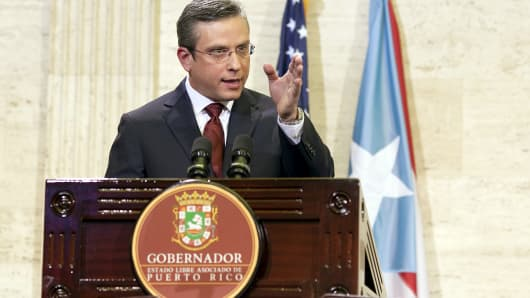 Puerto Rico Gov. Alejandro Garcia Padilla delivers his state of the Commonwealth address at the Capitol building in San Juan on April 30, 2015.
